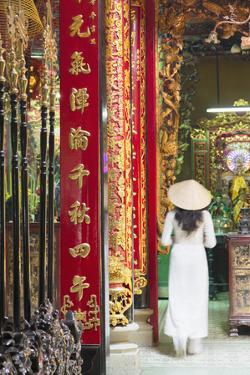 Woman Wearing Ao Dai Dress at Phuoc an Hoi Quan Pagoda, Cholon, Ho Chi Minh City, Vietnam by Ian Trower