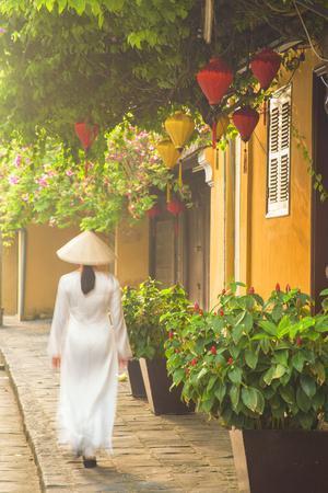 Woman Wearing Ao Dai Dress Walking Along Street, Hoi An, Quang Ham, Vietnam