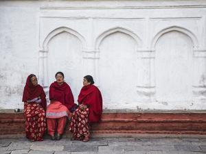 Women Sitting in Durbar Square (UNESCO World Heritage Site), Kathmandu, Nepal by Ian Trower