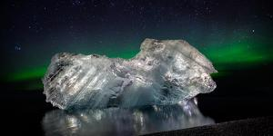 Ice with the Aurora Borealis. Ice Formations Come from the Jokulsarlon Glacial Lagoon
