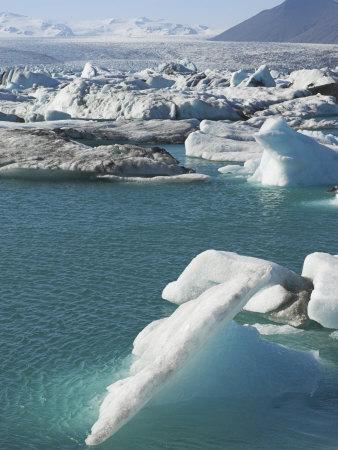 https://imgc.allpostersimages.com/img/posters/icebergs-in-the-glacial-melt-water-lagoon-at-jokulsarlon-iceland-polar-regions_u-L-P2R2FT0.jpg?artPerspective=n