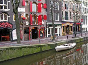White Boat in Red Lights District, Amsterdam by Igor Maloratsky