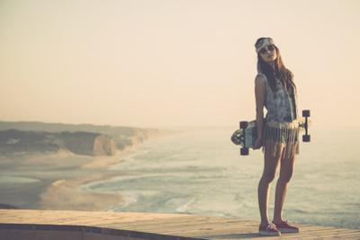 Beautiful And Fashion Young Woman Posing With A Skateboard by iko