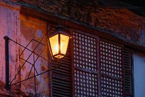 Illuminated vintage street lamp on wall, Calle Crisologo, Vigan, Ilocos Sur, Philippines