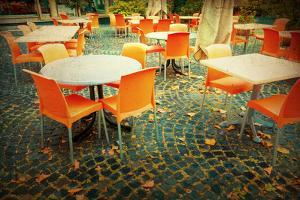 Old-Fashioned Coffee Terrace with Tables and Chairs,Paris France by ilolab