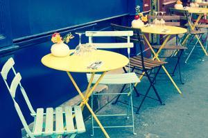 Street View of a Coffee Terrace with Tables and Chairs,Paris France by ilolab