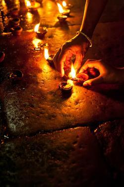 People Burning Oil Lamps as Religious Ritual in Hindu Temple. India by Im Perfect Lazybones