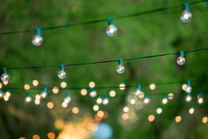 Hanging Decorative Christmas Lights For A Back Yard Party by imging