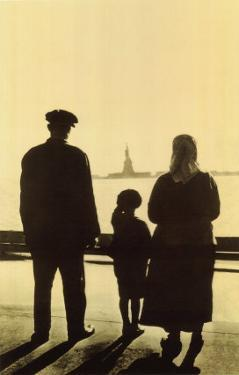 Immigrant Family Looking At Statue Of Liberty From Ellis Island