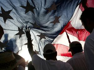 Immigration Rights Demonstrators Hold a U.S. Flag Aloft During a March Along Wilshire Boulevard