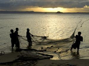Fishermen Pulling in the Nets at Dawn, Ramena Beach, Diego Suarez, North Madagascar by Inaki Relanzon