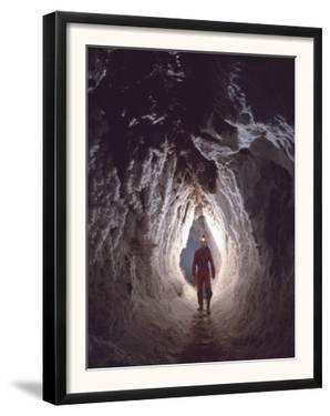 Potholer Wallking Along Narrow Underground Passage, Cova Lachambre, Ria, Conflent, Pyrenees, France by Inaki Relanzon