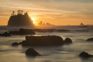 Rock Formations Silhouetted At Sunset On The Pacífic Coast Of Olympic National Park by Inaki Relanzon