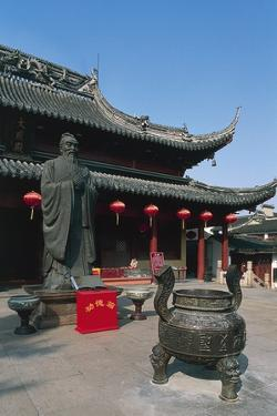 Incense Burner and Statue of Confucius