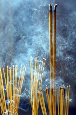 https://imgc.allpostersimages.com/img/posters/incense-sticks-on-joss-stick-pot-burning-and-smoke-used-to-pay-respect-to-buddha-taoist-temple_u-L-Q1GYLR70.jpg?artPerspective=n