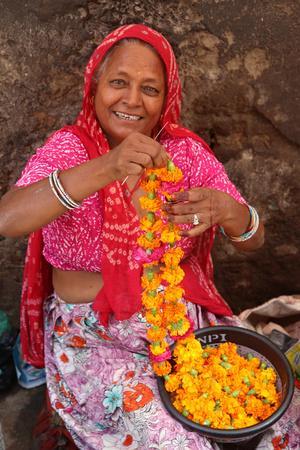 https://imgc.allpostersimages.com/img/posters/indian-woman-making-garlands-in-ajmer-rajasthan-india_u-L-Q1GYL500.jpg?artPerspective=n
