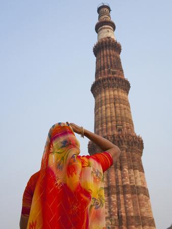 https://imgc.allpostersimages.com/img/posters/indian-women-at-qutb-minar-unesco-world-heritage-site-delhi-india_u-L-PHAON20.jpg?p=0
