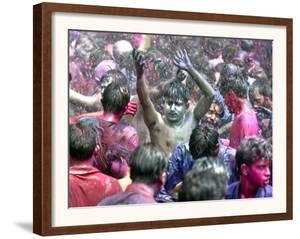 Indians, Faces Smeared with Color and Glitter, Celebrate Holi