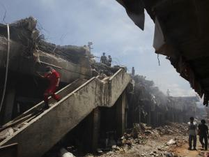 Indonesian Rescue Workers Walk on a Eartquake Damaged Building, in Padang, Indonesia