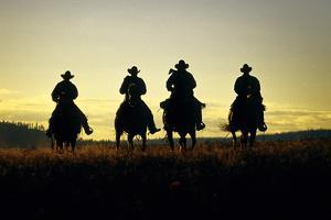 Cowboys Hitting the Trail at Sunrise, Oregon, USA by Inga Spence