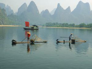 Fishermen on Bamboo Rafts, China by Inga Spence