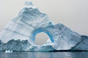 Antarctica. Charlotte Bay. Giant Iceberg with a Hole by Inger Hogstrom