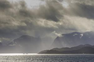 Greenland, Kangerlussuaq. Low clouds over the fjord. by Inger Hogstrom