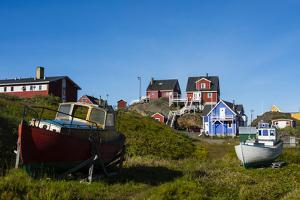 Greenland. Sisimiut. Fishing boats and colorful houses. by Inger Hogstrom