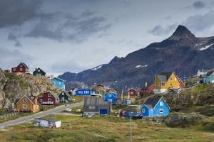 Greenland, Sisimiut. Nasaasaaq mountain towering above colorful Sisimiut. by Inger Hogstrom