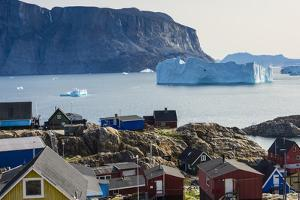 Greenland. Uummannaq. Colorful houses dot the rocky landscape. by Inger Hogstrom