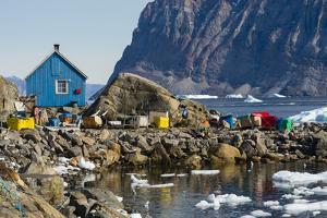 Greenland, Uummannaq. Ice fills the harbor. by Inger Hogstrom