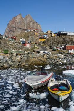 Greenland. Uummannaq. Ice fills the harbor. by Inger Hogstrom