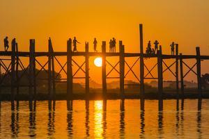 Myanmar. Mandalay. Amarapura. Tourists on the U Bein Bridge at Sunset by Inger Hogstrom