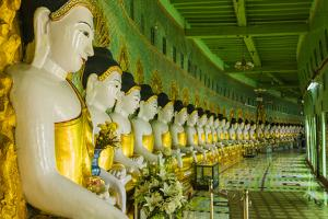Myanmar. Mandalay. Sagaing Hill. Thirty Caves Temple. Row of Buddhas by Inger Hogstrom