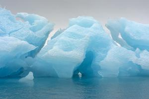 Norway. Svalbard. Brasvelbreen. Turquoise Ice Bergs in the Calm Water by Inger Hogstrom
