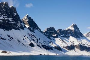 Norway. Svalbard. Hornsund. Dramatic Cliffs Tower over the Sound by Inger Hogstrom