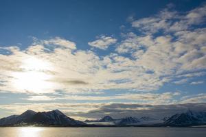 Norway. Svalbard. Spitsbergen. Forlandsundet. Clouds and Midnight Sun by Inger Hogstrom