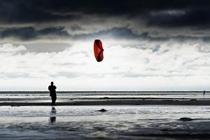 Germany, Schleswig-Holstein, Amrum, Sandy Beach, Sandbank, Kniepsand, Person Flying Kite by Ingo Boelter