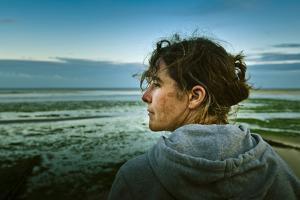 Germany, Schleswig-Holstein, Amrum, Sandy Beach, Sandbank, Kniepsand, Woman, Portrait, Side View by Ingo Boelter