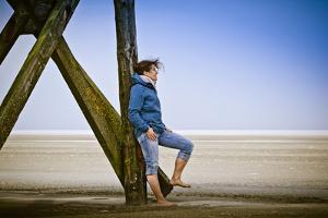 Germany, Schleswig-Holstein, Nordfriesland, Eiderstedt, Sankt Peter-Ording, Woman on the Beach by Ingo Boelter
