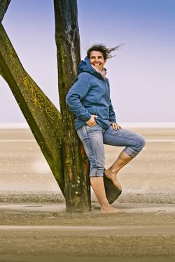 Germany, Schleswig-Holstein, North Frisia, Eiderstedt, St. Peter-Ording, Woman on the Beach by Ingo Boelter