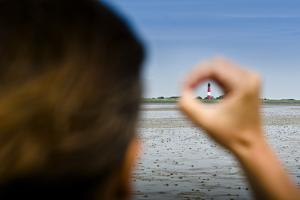 Germany, Schleswig-Holstein, Pellworm, Mud Flats, Wadden Sea, Lighthouse, Woman, Hand, Finger, View by Ingo Boelter