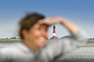 Germany, Schleswig-Holstein, Pellworm, Mud Flats, Woman, View, Portrait, Lighthouse in Background by Ingo Boelter