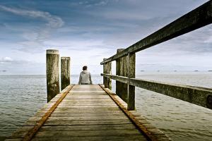 Germany, Schleswig-Holstein, Wyk, Beach, Woman, Bridge, Sitting, Back View by Ingo Boelter