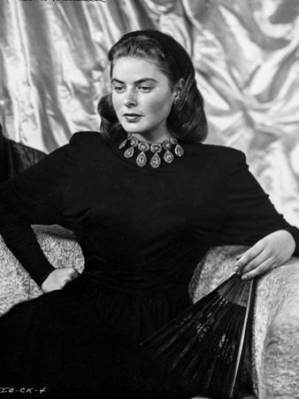 Ingrid Bergman sitting on a Couch in Black Dress by E Bachrach
