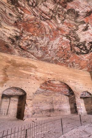 https://imgc.allpostersimages.com/img/posters/inside-the-urn-tomb-royal-tombs-petra-jordan-middle-east_u-L-PWFR3I0.jpg?artPerspective=n