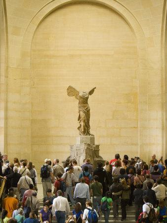 https://imgc.allpostersimages.com/img/posters/interior-of-the-louvre-museum-showing-winged-victory-statue-and-tourists-paris-france_u-L-P2490H0.jpg?p=0