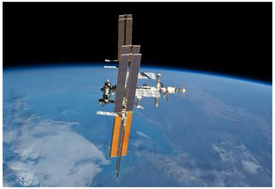 https://imgc.allpostersimages.com/img/posters/international-space-station-planet-earth-2011-photo-poster_u-L-F59AO60.jpg?artPerspective=n