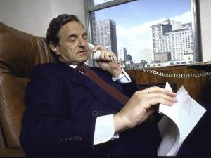 Investment Banker George Soros Working on Phone in Office
