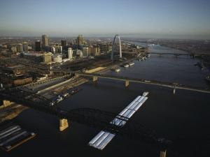 Aerial View of Barges Traveling the Mississippi River Past St. Louis by Ira Block